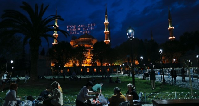 People gather together at Sultanahmet Square, Istanbul after iftar. Home to the Blue Mosque, Hagia Sophia and the Topkapı Palace, Sultanahmet is one of the most frequently visited places during Ramadan.