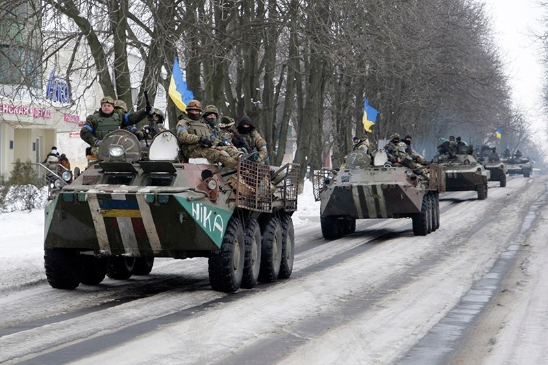 Members of the Ukrainian armed forces drive armored vehicles in the town of Volnovakha, eastern Ukraine, January 18, 2015. (Reuters Photo)