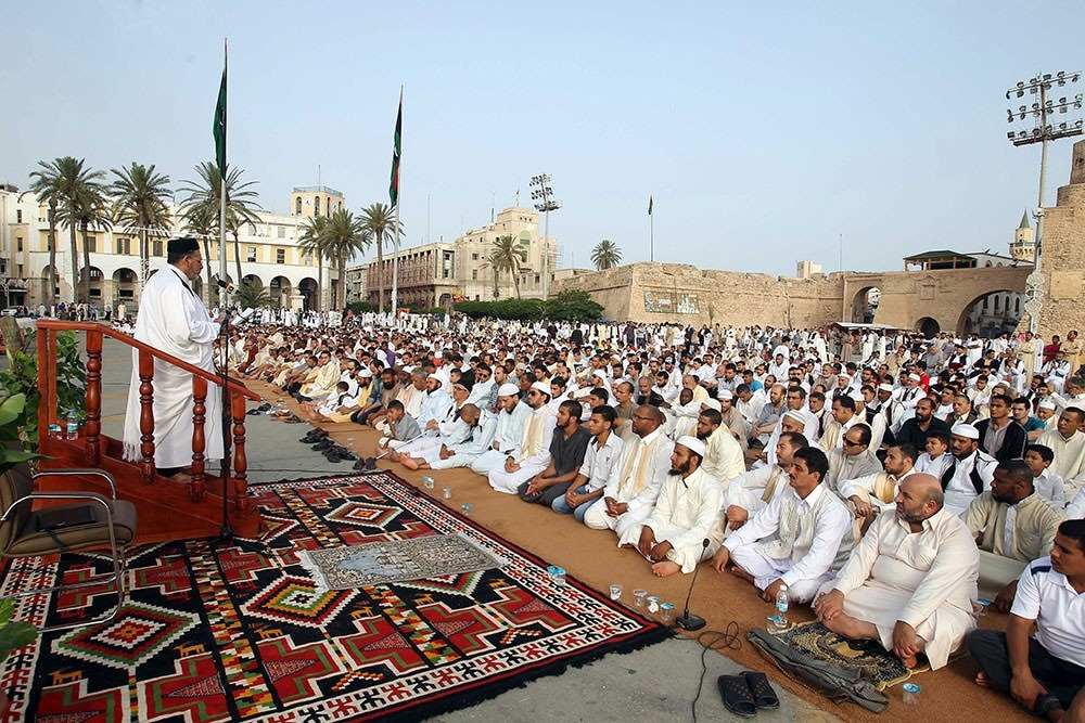 Muslims pray on the first day of the Eid at the Martyrs' Square, in Tripoli, Libya