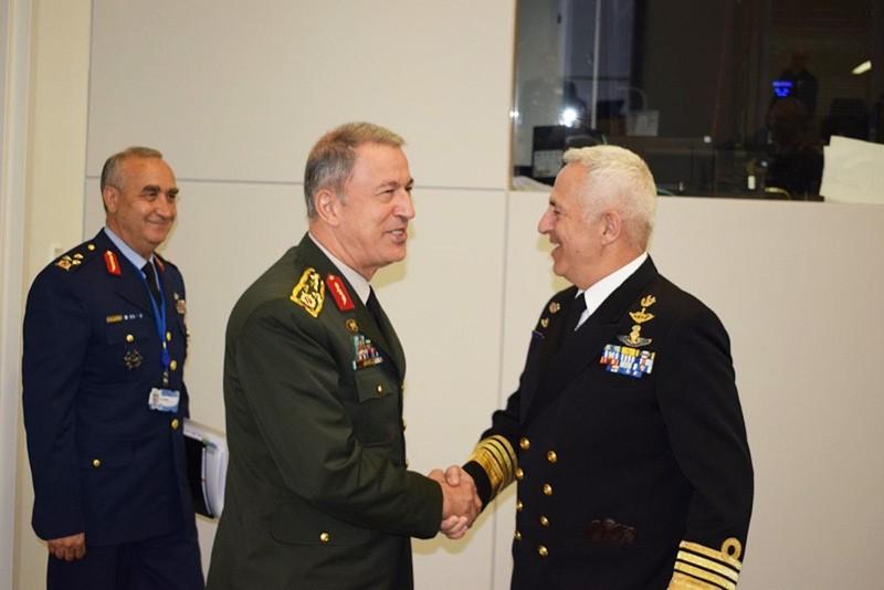 Chief of Staff Gen. Hulusi Akar greets Greek counterpart Admiral Evangelos Apostolakis in Brussels. (IHA Photo)