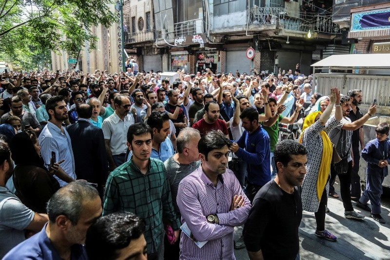 A group of protesters chant slogans at the old grand bazaar in Tehran, Iran, Monday, June 25, 2018. (Iranian Labor News Agency via AP)