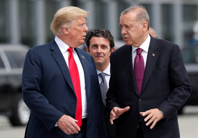 U.S. President Trump and President Erdoğan gesture as they talk at the start of the NATO summit in Brussels, Belgium, July 11.