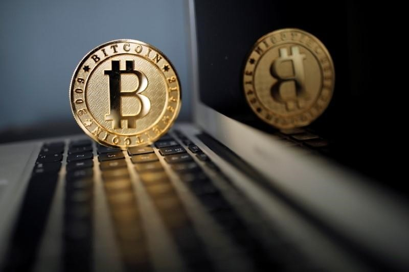 A Bitcoin (virtual currency) coin is seen in an illustration picture taken at La Maison du Bitcoin in Paris, France, June 23, 2017 (Reuters Photo)