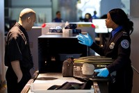 The U.S. is asking the world's airlines to institute a ban on personal electronics in checked luggage, citing a fire risk, according to a report published Thursday.