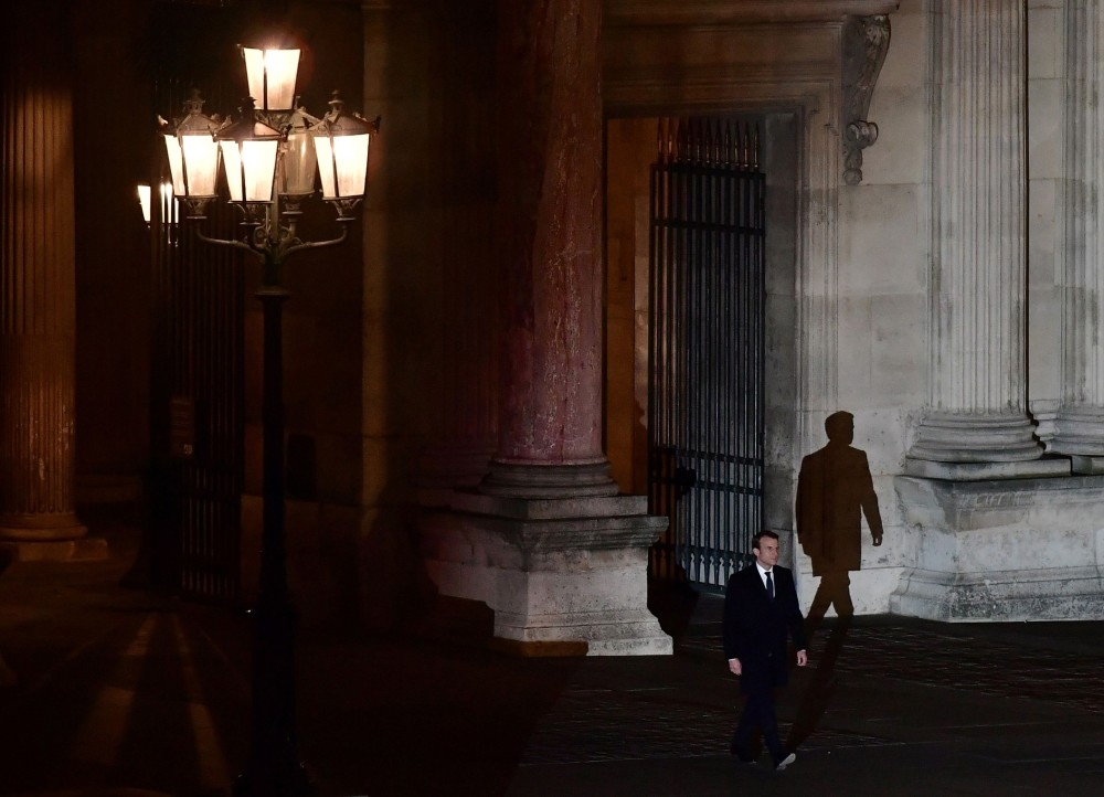 French president-elect Emmanuel Macron greets supporters as he arrives to deliver a speech in front of the Pyramid at the Louvre Museum in Paris on May 7.
