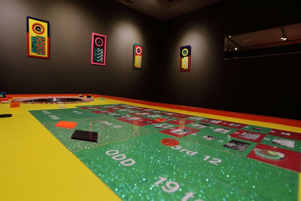 The gallery resembles a casino and visitors are invited to place play bets on the roulette table, and by doing so, change the fates of numerous people whose life stories Duben meticulously collected over the years.