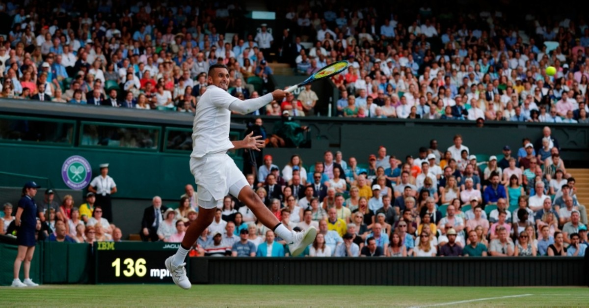 Australia's Nick Kyrgios returns against Spain's Rafael Nadal during their men's singles second round match on the fourth day of the 2019 Wimbledon Championships at The All England Lawn Tennis Club in Wimbledon, on July 4, 2019. (AFP Photo)