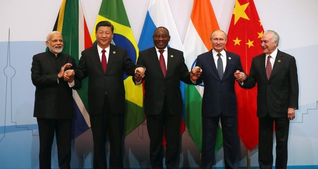 (From left to right) Indian Prime Minister Narendra Modi, China's President Xi Jinping, South Africa's President Cyril Ramaphosa, Russia's President Vladimir Putin and Brazil's President Michel Temer