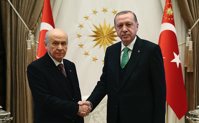 MHP Chairman Bahçeli shakes hands with AK Party chairman, President Recep Tayyip Erdoğan, before their talks in Ankara, Feb. 18, 2018.