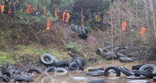 The abandoned tires were collected from the pond in Istanbul's ?ile district earlier this week. DHA Photo