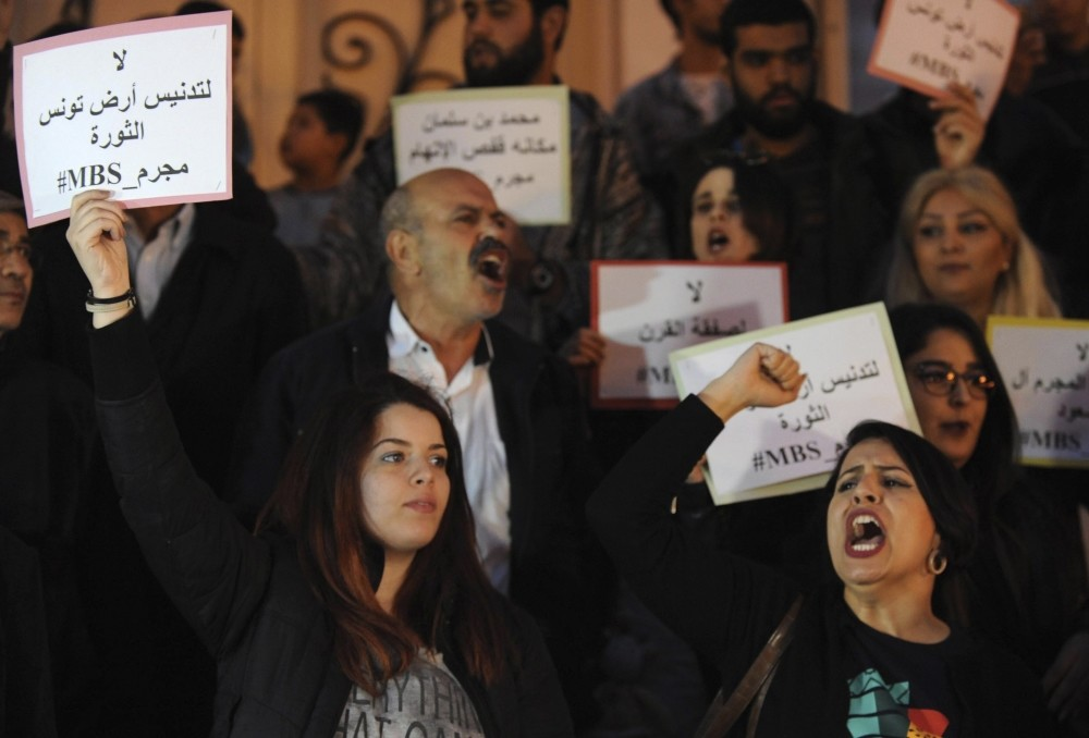 Protestors hold placards reading in Arabic u201cno to the desecration of Tunisia, the land of the revolutionu201d during a protest against the visit of MBS in Tunis, Tunisia, Nov. 26.