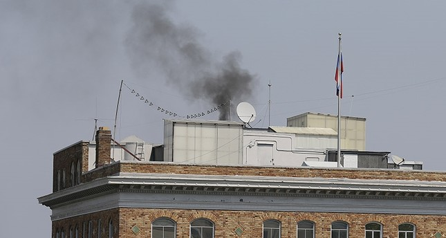 Black smoke rises from the roof of the Consulate-General of Russia Friday, Sept. 1, 2017, in San Francisco. (AP Photo)