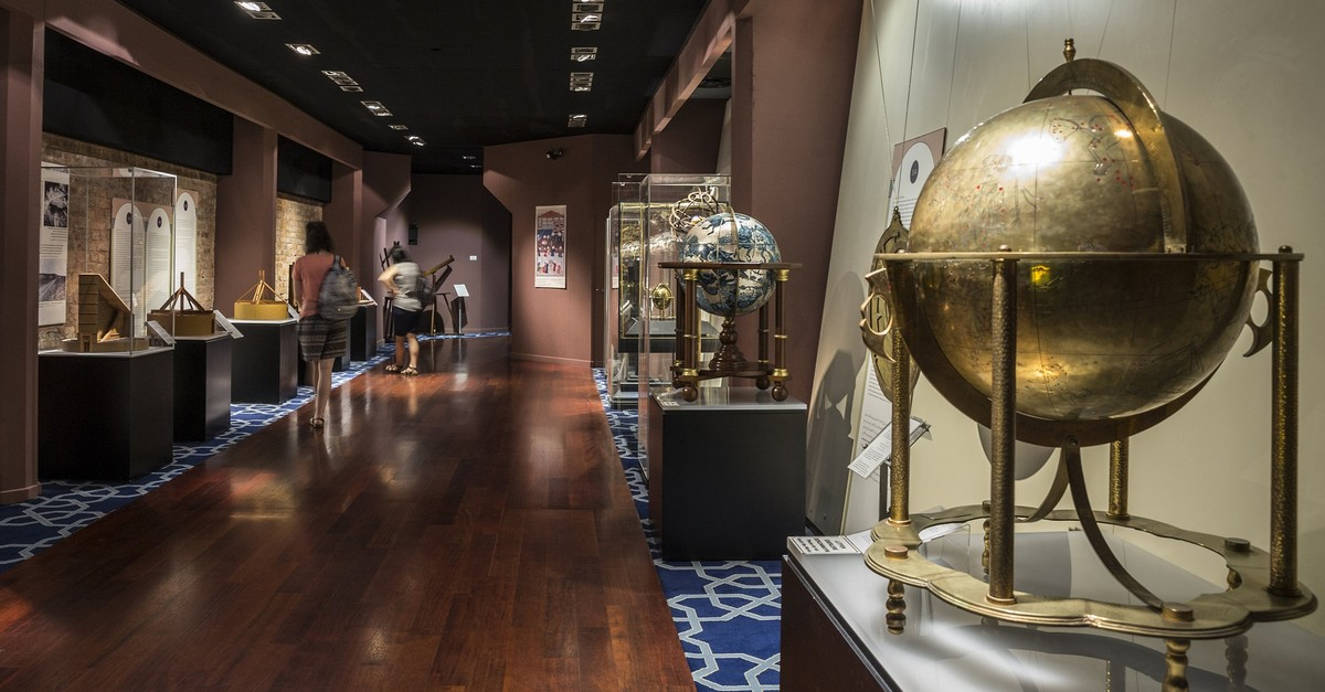 Works of Muslim scientists are showcased through examples and visuals in the center.