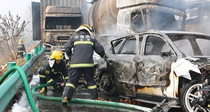 pA highway pile-up involving at least 30 cars killed 18 people in eastern China on Wednesday, local authorities said, leaving dramatic scenes of twisted and burnt-out wreckage and a towering column...