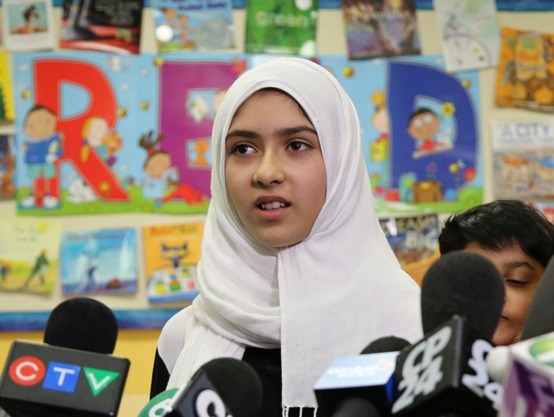 Khawlah Noman, 11, speaks to reporters at Pauline Johnson Junior Public School, after she told police that a man cut her hijab with scissors in Toronto, Ontario, Canada Jan. 12, 2018 (Reuters Photo)