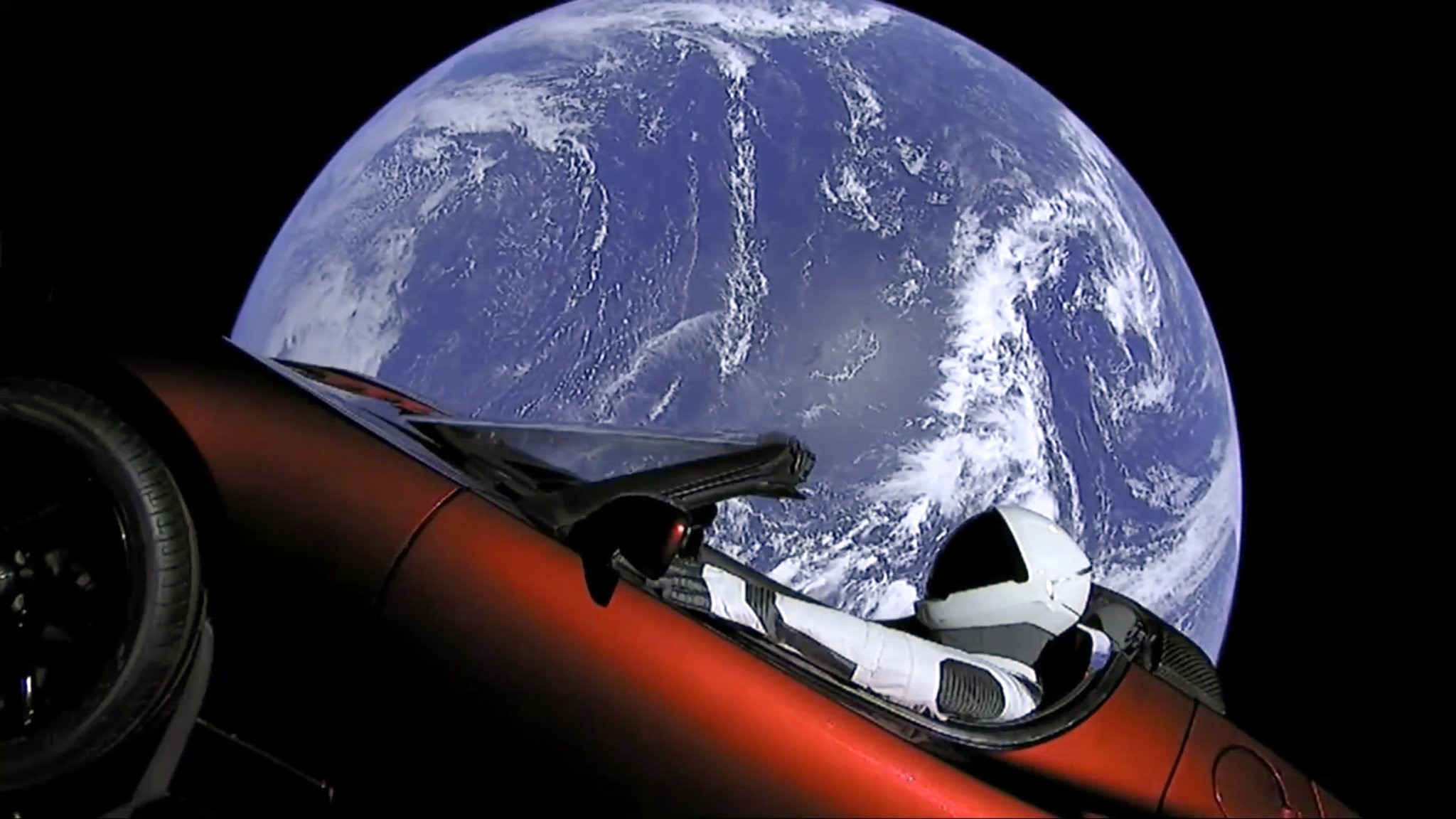 An image from video provided by SpaceX shows the companyu2019s spacesuit in Elon Musku2019s red Tesla sports car, which was launched into space during the first test flight of its Falcon Heavy rocket on Tuesday.