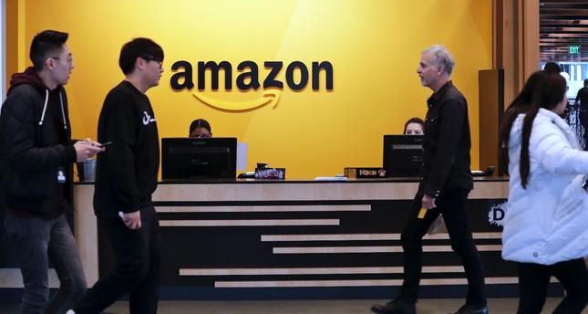 Employees walk through a lobby at Amazon's headquarters, Seattle, Nov. 13.