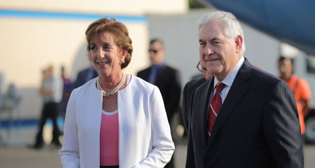 In this file photo taken on December 19, 2016 US Secretary of State Rex Tillerson is welcomed by US ambassador Roberta Jacobson (L) as he arrives at Benito Juarez international Airport in Mexico City, Mexico. (AFP PHOTO)