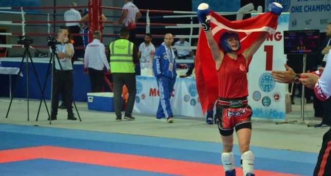 Duygu Turan carries the Turkish flag after winning a gold medal at the championships. AA Photo