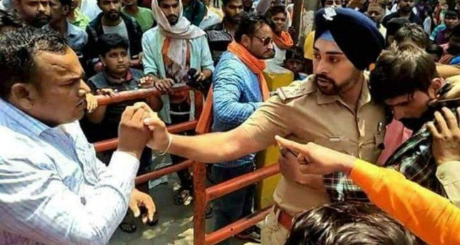 Sikh police officer Gagandeep Singh saves Muslim man from mob in Ramnagar district, Uttarakhand state, India. (Image from Twitter)
