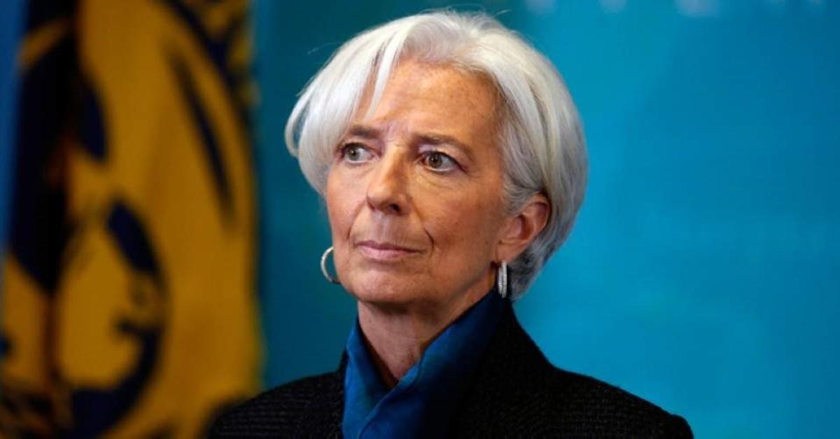 International Monetary Fund (IMF) Managing Director Christine Lagarde, waits to greet British Prime Minister David Cameron, before a round table meeting at the IMF, Thursday, Jan. 15, 2015 in Washington. (AP Photo)
