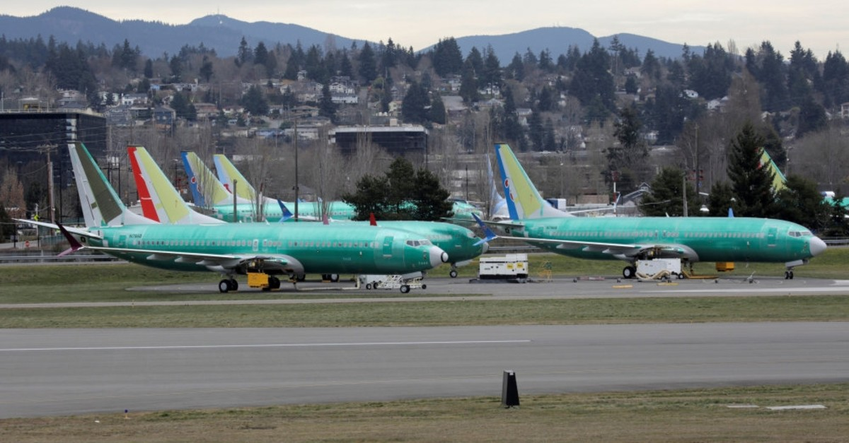 Boeing 737 MAX aircraft, including two 737 MAX 8 aircraft bearing the logo of China Southern Airlines, third from left and another seen at right, are parked at a Boeing production facility in Renton, Washington, U.S., March 11, 2019.