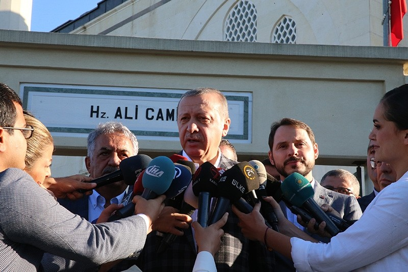 President Recep Tayyip Erdou011fan speaks to reporters after prayers for the Qurban Bayram in Istanbul, Turkey September 1, 2017. (Presidential Photo Service via AA)