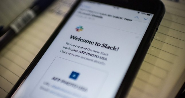 This image shows the Slack application displayed on a smarthphone screen in Washington on February 04, 2019. (AFP Photo)