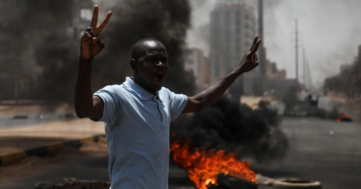 This file photo dated June 3, 2018 shows a protester near a barricade with burning tires in capital Khartoum. (AA Photo)