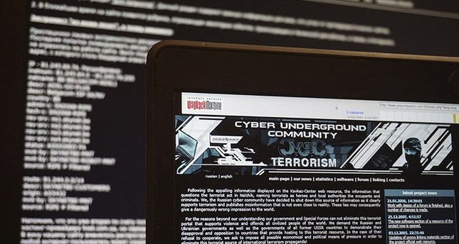 This is a  July 24, 2017 file photo of archived versions of two Russian anti-terrorism websites on a computer screen are photographed, in Paris. (AP Photo)