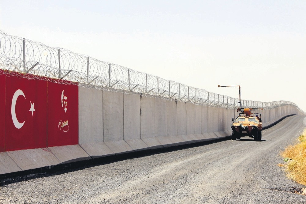 A Turkish military vehicle passes by a perimeter wall on Turkey's southern border with Syria's Idlib, as worries about a possible offensive against the Syrian province and its consequences are discussed by world and regional powers, Aug. 30.