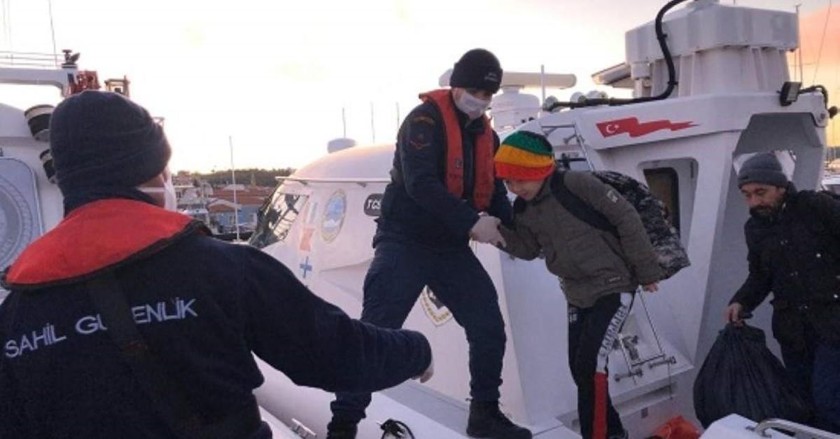 Coast Guard Command officers bring migrants ashore in Izmir, Feb. 4, 2020. (AA Photo)