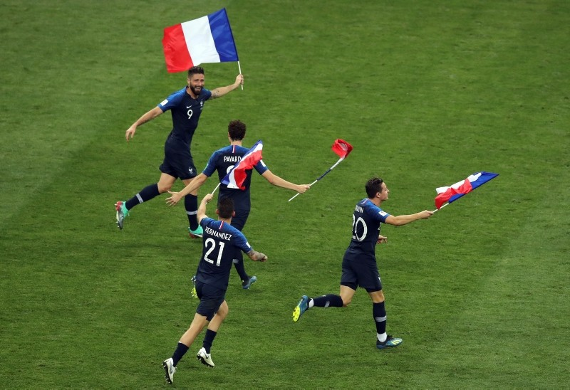 France's Olivier Giroud, left, and his teammates celebrate at the end of the final match between France and Croatia at the 2018 soccer World Cup in Moscow, Russia, Sunday, July 15, 2018. (AP Photo)