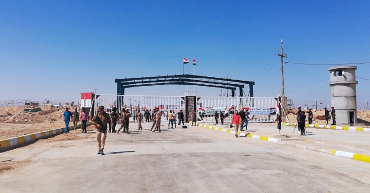 Iraqi and Syrian border guards prepare to open the crossing between the Iraqi town of Qaim and Syria's Boukamal in Anbar province, Iraq, Monday, Sept. 30, 2019. (AP Photo)