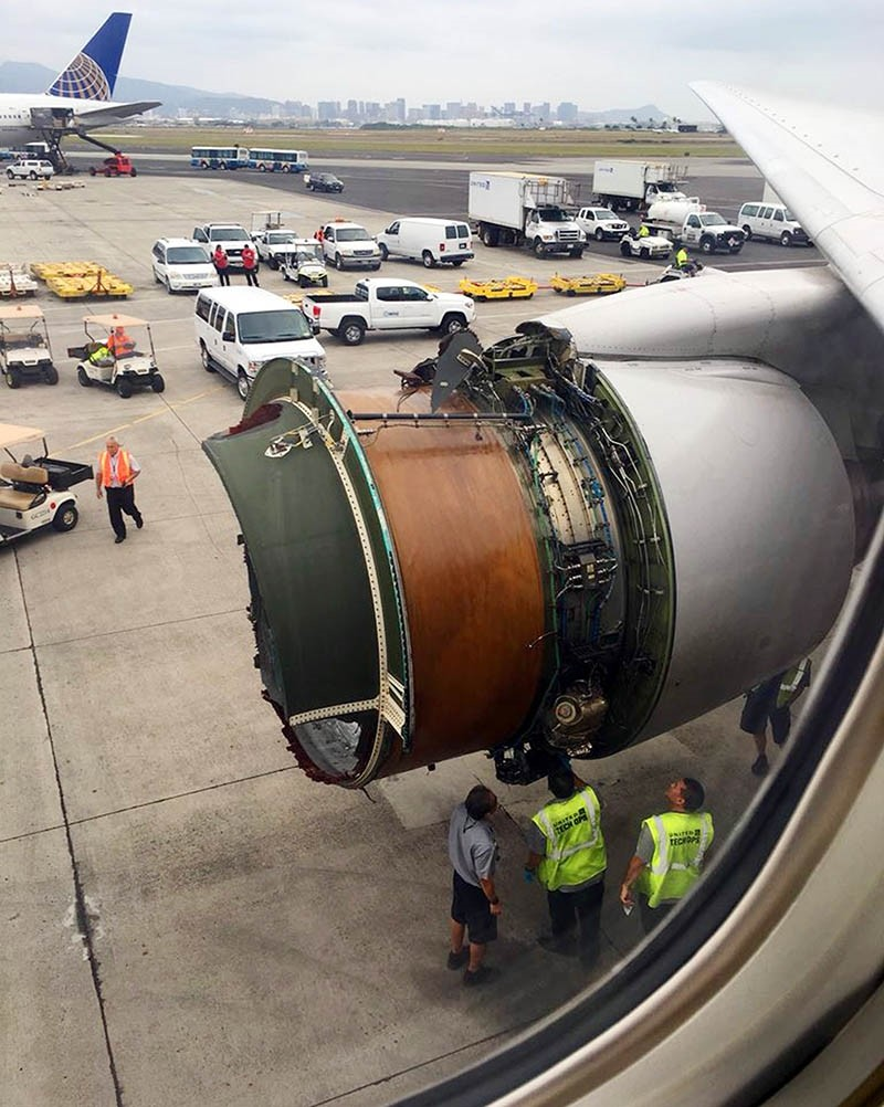 This photo provided by passenger Haley Ebert shows damage to an engine on what the FAA says is a Boeing 777 after parts came off the jetliner during its flight from San Francisco to Honolulu Tuesday, Feb. 13, 2018. (AP Photo)