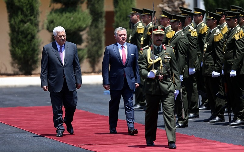 King Abdullah II of Jordan (R) and the Palestinian President Mahmoud Abbas (L) inspect honor guards during the welcoming ceremony in the West Bank town of Ramallah, August 7, 2017. (EPA Photo)