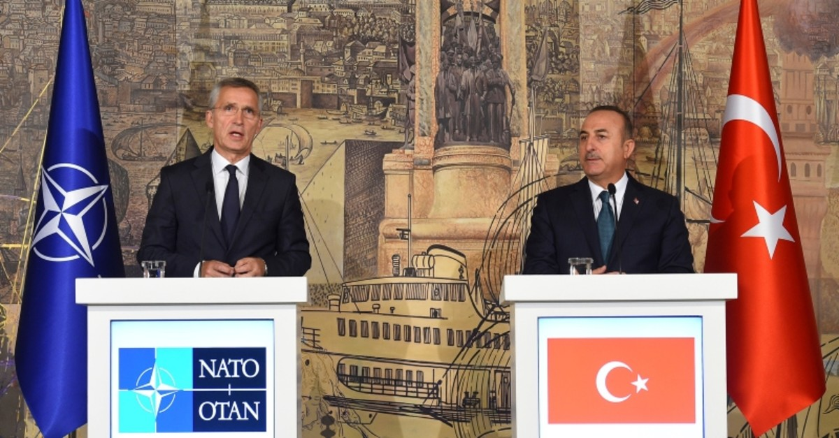 Foreign Minister Mevlut Cavusoglu, right, and NATO Secretary General Jens Stoltenberg speak to the media during a joint press conference after their meeting in Istanbul, Friday, Oct. 11, 2019 (AP Photo)