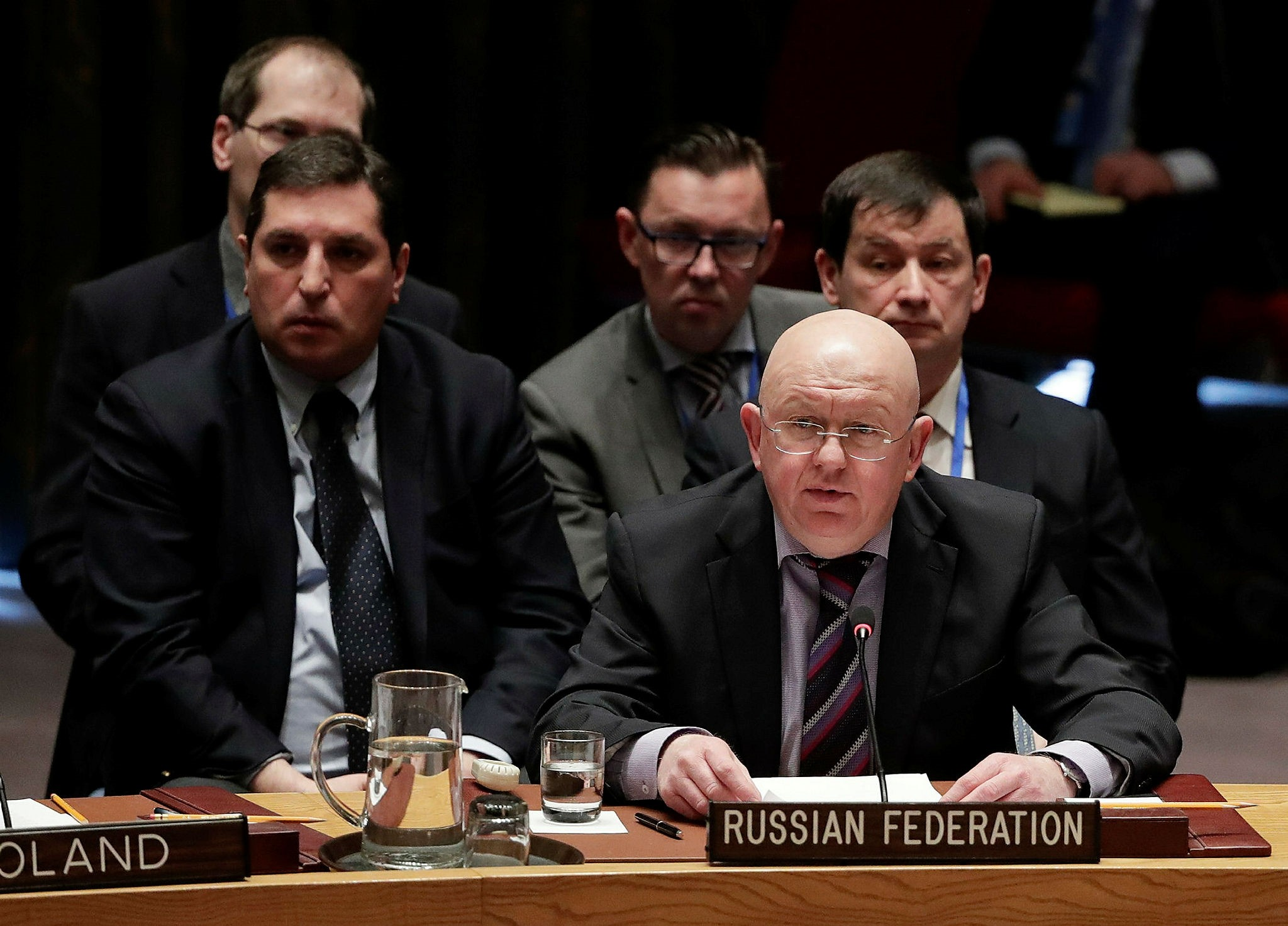 Russian Ambassador to the United Nations Vasily Nebenzya, right, talks before a vote during a Security Council meeting, Tuesday, April 10, 2018, at United Nations headquarters. (AP Photo)