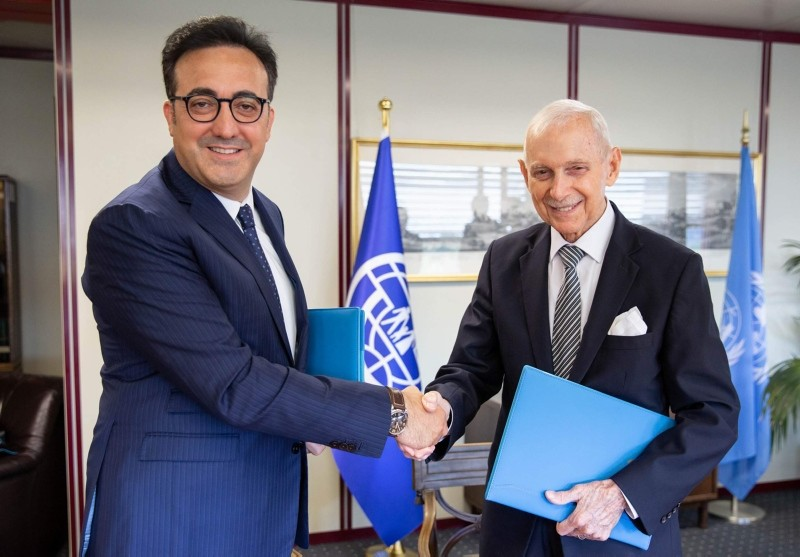 Turkish Airlines Chairman M. Ilker Aycu0131 (L) meets with IOM Director-General William Swing (R) in Geneva, 10 Sept. 2018. (AA Photo)