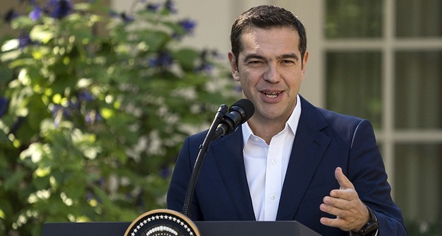 Greek Prime Minister Alexis Tsipras speaks during a news conference with President Donald Trump in the Rose Garden of the White House in Washington, Tuesday, Oct. 17, 2017. AP Photo