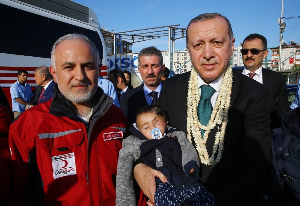 Baby Karim with President Erdou011fan (R) and Kerem Ku0131nu0131k, head of the Turkish Red Crescent.