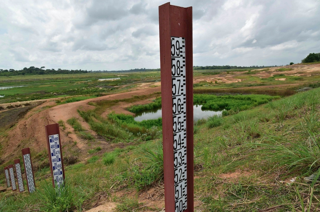 Poles indicating the water level at the Asseche Dam in Angoua-Yaokro near Bouake, Ivory Coast.