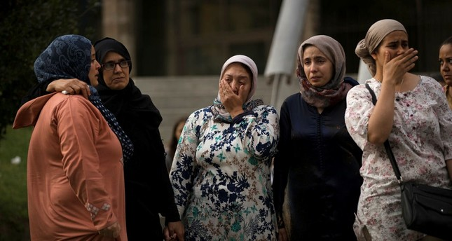 Families of young men believed responsible for the attacks gather along with members of the local Muslim community to denounce terrorism. (AP Photo)