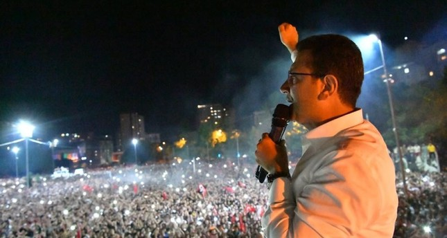 Istanbul's mayor-elect CHP's Ekrem Imamoğlu addresses supporters in home district Beylikdüzü after election victory (IHA Photo)