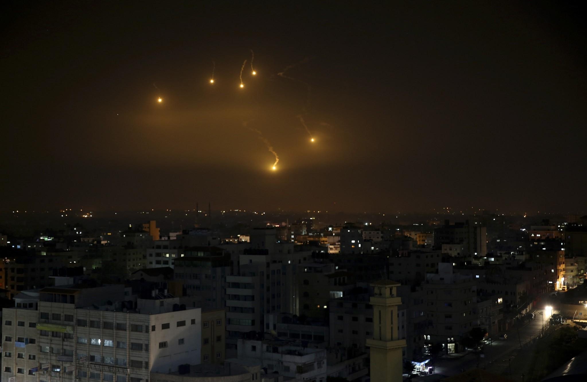 Israeli forces' flares light up the night sky of Gaza City, Monday, Feb. 6, 2017. (AP Photo)