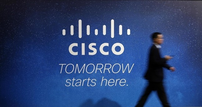 A visitor walks past a Cisco advertising panel at the Mobile World Congress in Barcelona February 27, 2014. (REUTERS Photo)