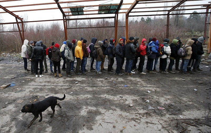 Migrants queue for food in an abandoned factory in the western Serbian town of Sid, near Serbia's border with European Union member Croatia, Monday, Dec. 18, 2017. (AP Photo)