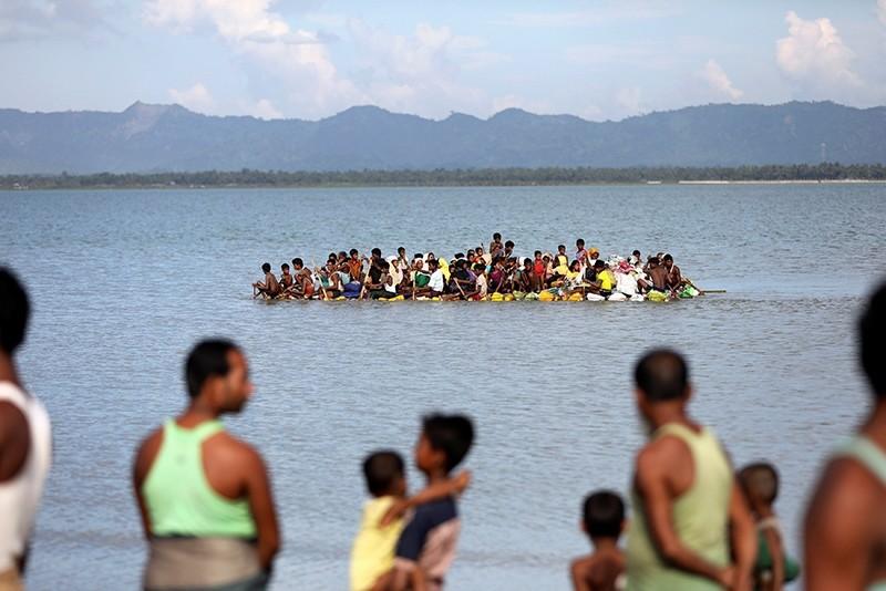Rohingya refugees cross the Naf River with an improvised raft to reach to Bangladesh in Teknaf, Bangladesh, Nov. 12, 2017. (Reuters Photo)