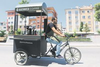 Man opens coffee shop on three wheels