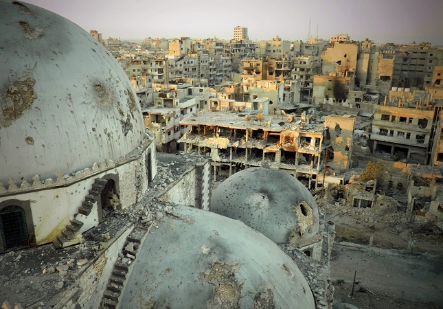 The Khalid ibn al-Walid Mosque seen after being partially destroyed in clashes during the Syrian civil war, Homs province, Syria, July 25, 2013.